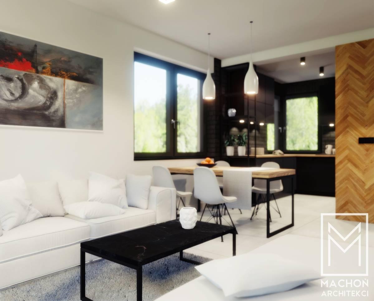 projekt nowoczenego mieszkania drewniane klepki na ścianie czarna kuchnia blat drewniany jasne meble w salonie
